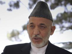 Afghan President Hamid Karzai speaks during a press conference at the presidential palace in Kabul, Afghanistan on Tuesday.