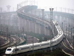 A train makes a trial run in Shanghai last month on a highly anticipated high-speed rail line to Beijing.