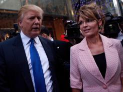 Former   Alaska governor Sarah Palin and Donald Trump walk toward a limo after leaving Trump Tower in New York on Tuesday.