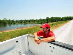 David Bell, a Corps of Engineers sector commander, travels 50 miles of levees in Vicksburg, Miss.