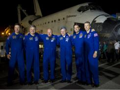 Endeavour astronauts, from left, the European Space Agency's Roberto Vittori; Gregory Johnson, pilot; Mark Kelly, commander; and Michael Fincke, Greg Chamitoff and Andrew Feustel, all mission specialists, The crew posed for a group photograph shortly after landing in Florida.