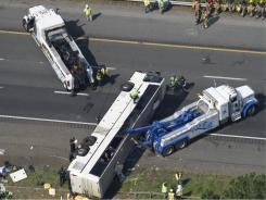 Rescue personnel work on a bus that overturned in Bowling Green, Va., on Tuesday.