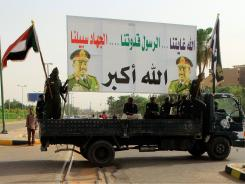 Sudanese security forces hold up a billboard bearing President Omar al-Bashir's portrait, on their way to a rally organized by the government at the Defense Ministry in Khartoum.