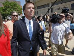 John Edwards leaves the Federal Building in Winston-Salem, N.C., on Friday.