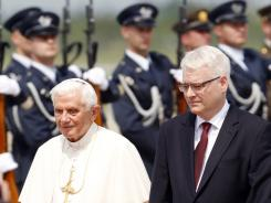 Pope Benedict XVI inspects Croatian honor guards accompanied by Croatia's president Ivo Josipovic, right, upon his arrival at the Zagreb airport Saturday.