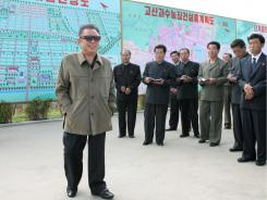 Amid reports of famine, Kim Jong Il visits the Kosan Fruit Farm in this photo from the Korean Central News Agency