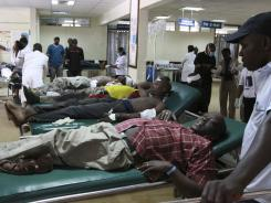 Victims from a blast receive medical attention Sunday at the Kenyatta hospital in Nairobi.