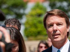 Former senator John Edwards exits a federal courthouse and speaks to a crowd on Friday in Winston-Salem, N.C.
