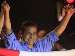 Peru's new president,  Ollanta Humala,  celebrates in Lima.