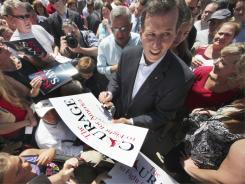 Former senator Rick Santorum works the crowd Monday in Somerset, Pa.