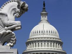 The Capitol in Washington, D.C., is seen with a marble chimera rhyton that stands in front of the Rayburn House Office Building in the foreground.