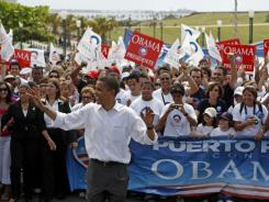 Then-Sen. Obama led a rally during the 2008 campaign. The island went for Hillary Rodham Clinton, but Obama said he would return if he won.