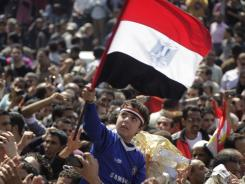 A boy holds up the Egyptian flag in a Cairo protest on March 18.
