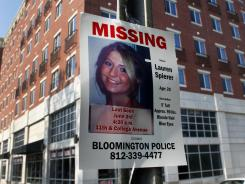 A missing person poster of Lauren Spierer, 20, who was last seen early Friday, is posted outside her apartment building in Bloomington, Ind.