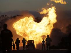 A massive fire roars through a mostly residential neighborhood in San Bruno, Calif., on Sept. 9, 2010.