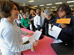 Unemployed teacher P.M. Zinga, right, attends a job fair in Los Angeles on June 2.
