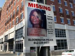 A missing-person poster of Lauren Spierer, 20, who was last seen early Friday, is posted outside her apartment building in Bloomington, Ind.