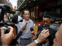 Rep. Anthony Weiner is questioned by the media near his home in the Queens borough of New York Saturday.