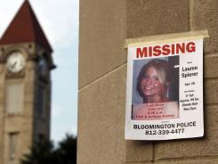 A missing person poster of Lauren Spierer, 20, is posted on one of the entry gates to Indiana University in Bloomington, Ind., on Wednesday.