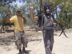 Rebel fighters are seen before a heavy fight against pro-Gadhafi forces in Dafneya, Libya, on Sunday.