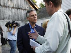 Possible 2012 presidential hopeful Jon Huntsman listens to a reporter's question in Salem, N.H., on Friday.