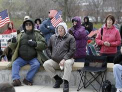 Tea Party supporters listen to Herman Cain at an April rally. He will return to the state on a Tea Party bus tour.