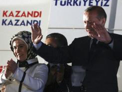 Turkish Prime Minister Recep Tayyip Erdogan addresses his supporters gathered in front of his Justice and Development Party headquarters in Ankara, Turkey, late Sunday.