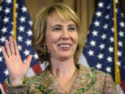 In this Jan. 5, 2011, photo, Rep. Gabrielle Giffords takes part in a reenactment of her swearing-in on Capitol Hill.