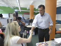 Republican presidential hopeful, former Massachusetts Gov. Mitt Romney, meets businesswoman Jennine Hynes in Detroit, Thursday, June 9.