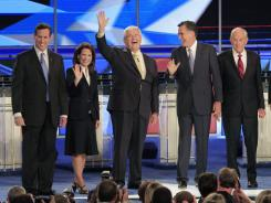 From left, Rick Santorum, Rep. Michele Bachmann, Newt Gingrich, Mitt Romney, Rep. Ron Paul, Tim Pawlenty and Herman Cain at the debate Monday.
