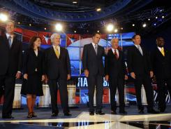 Republican candidates, from left to right: former senator Rick Santorum of Pennsylvania, U.S. Rep. Michele Bachmann of Minnesota; former House speaker Newt Gingrich, former governor Mitt Romney of Massachusetts, U.S. Rep. Ron Paul of Texas, former governor Tim Pawlenty of Minnesota, and businessman Herman Cain.