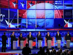 GOP hopefuls gathered at the first debate of the 2012 campaign season Monday. From left, Rick Santorum, former senator from Pennsylvania; Rep. Michele Bachmann of Minnesota; former House speaker Newt Gingrich; former Massachusetts governor Mitt Romney; Texas Rep. Ron Paul; former Minnesota governor Tim Pawlenty; and entrepreneur Herman Cain.