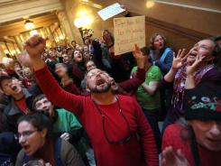 Demonstrators protest Wisconsin Gov. Scott Walker's attempt to push through a bill restricting collective bargaining for most government workers at the state capitol on March 1.
