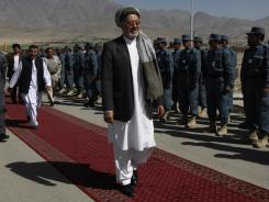 Afghanistan's second Vice President Mohammed Karim escaped injury when a mortar round struck a police building where an inauguration ceremony was underway.