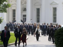 Members of Congress exit the White House after a June 1 meeting with President Obama about the national debt limit and budget plans.