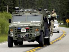 A Missoula County Sheriff's Department SWAT team respond to a tip about about person living in a remote cabin near Lola. Mont., that they suspected might be fugitive David Burgert.