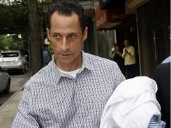 Rep. Anthony Weiner, D-N.Y., carries his laundry to a laundromat near his home in the Queens borough of New York, Saturday.