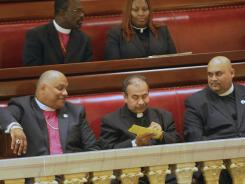 Clergy members take notes during a session of the New York state Senate in Albany, N.Y., June 17.