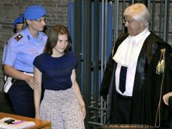 Amanda Knox, second from left, walks past her lawyer Luciano Ghirga, as she arrives in court for the appeal trial Saturday in Perugia, Italy.