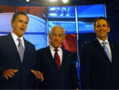 Republican candidates, from left, Mitt Romney, Ron Paul and Tim Pawlenty were critical of President Obama's economic policies in a debate last Monday in New Hampshire.