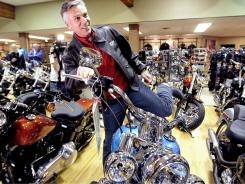 Former Utah governor Jon Huntsman checks out a Harley-Davidson during a recent stop in Manchester, N.H.