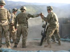 Troops at Combat Outpost Honaker Miracle in Kunar province practice firing mortar rounds. Under a steady barrage of Taliban attacks, they are ever on their guard.