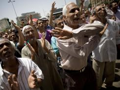 Egyptian protesters shout slogans June 10 as they call for democratic changes and a speedy trial of former president Hosni Mubarak.
