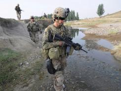 U.S. soldiers patrol the Sabari district Tuesday in Khost province, Afghanistan.