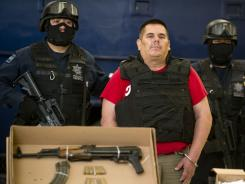 "Jose de Jesus Mendez, aka ""El Chango, member of 'La Familia' drug cartel, is presented to the press at the Mexican Federal Policer headquarters in Mexico City Wednesday."