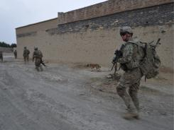 U.S. soldiers walk through a village in eastern Afghanistan on Wednesday.