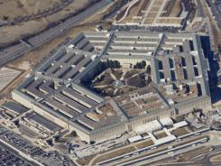 File shot of the Pentagon was taken from Air Force One, with President Obama on board. The president's new executive orders delegate how cyber warfare may be waged.