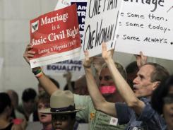 Gay marriage supporters and opponents rally at the Capitol in Albany, N.Y., Wednesday.