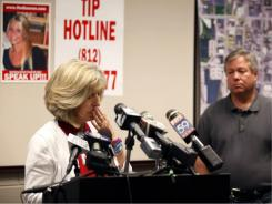 Charlene Spierer again asks anyone with information on her daughter Lauren Spierer to come forward while Robert Spierer listens during a news conference at the Bloomington, Ill., Police Department on Wednesday.