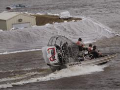 response workers navigate floodwater from the Souris River on June 25, 2011, in Minot.